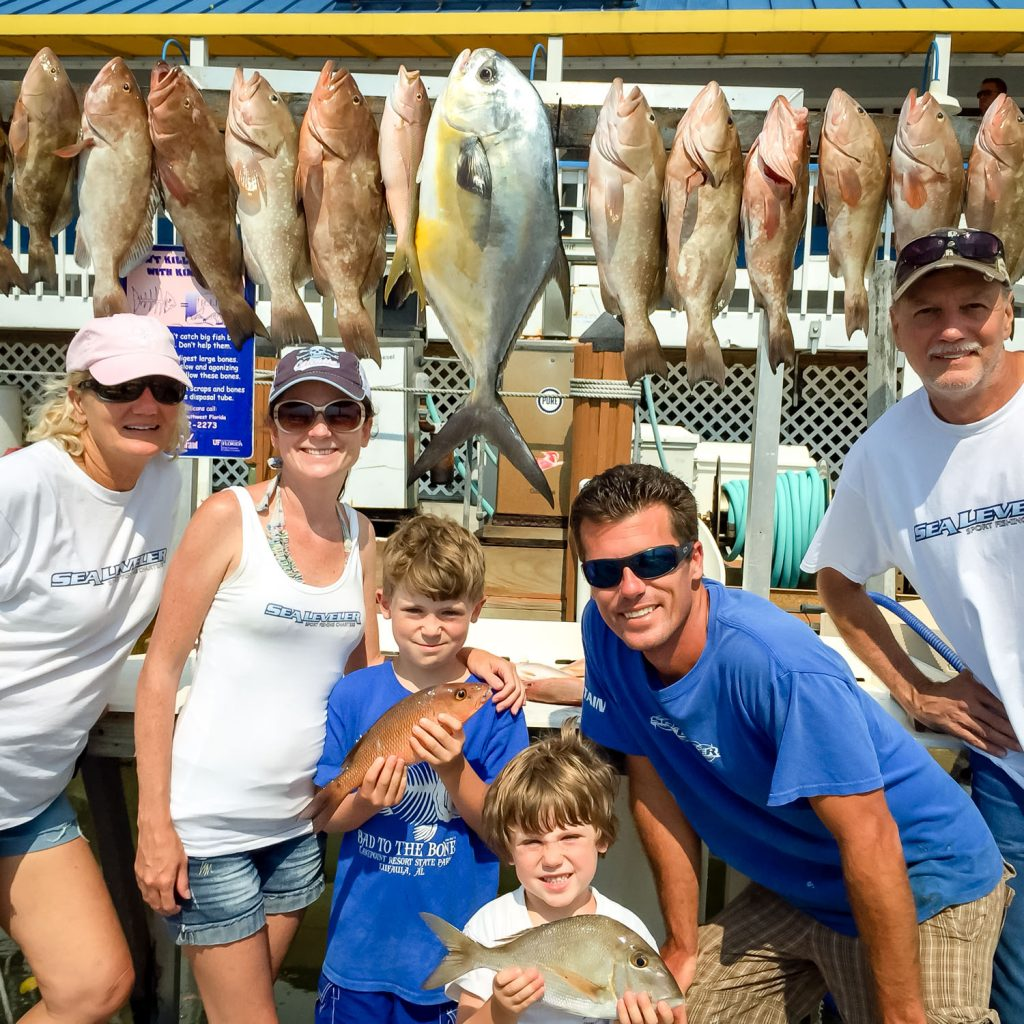 Family with fish they caught in Naples FL